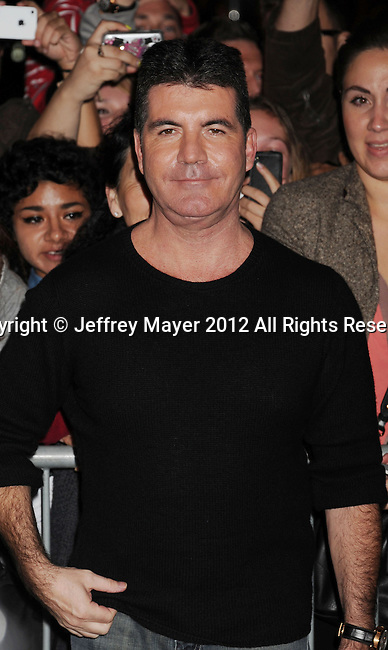 LOS ANGELES, CA - DECEMBER 06: Simon Cowell  arrives at the 'The X Factor' Viewing Party Sponsored By Sony X Headphones at Mixology101 & Planet Dailies on December 6, 2012 in Los Angeles, California.