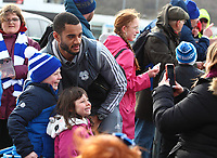 29th February 2020; Cardiff City Stadium, Cardiff, Glamorgan, Wales; English Championship Football, Cardiff City versus Brentford; Curtis Nelson of Cardiff City  has a photo with Cardiff City fans outside the stadium as players arrive