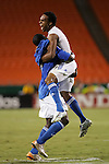 Aug 22 2007:  Scott Sealy (19) of the Wizards jumps into the arms of teammate Eddie Johnson to celebrate his goal.  The MLS Kansas City Wizards defeated the visiting Chicago Fire 3-2 at Arrowhead Stadium in Kansas City, Missouri, in a regular season league soccer match.
