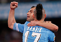 Naples's Goran Pandev celebrates  with his teammate  Marek Hamsikafter scoring against Genoa during their Italian Serie A soccer match at the San Paolo  stadium in Naples April 7, 2013