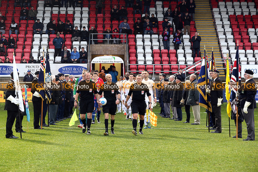The players and officials are led out between members of the armed forces before Dagenham & Redbridge vs Gateshead, Vanarama National League Football at the Chigwell Construction Stadium on 12th November 2016