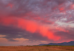 """A rare """"painted sky"""" with shades of crimson in the clouds over the Talent hills"""
