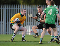 5th October 2013; Lucan Sarsfields goalkeeper, Fergus O'Gordain, in action against Craigh Lowndes, St Peregrines. Dublin Senior Football Championship, St Peregrines v Lucan Sarsfields, Blakestown, Dublin. Picture credit: Tommy Grealy / Actionshots.ie