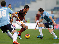 Calcio, Serie A: Roma vs Lazio. Roma, stadio Olimpico, 8 novembre 2015.<br /> Roma's Iago Falque, left, is challenged by Lazio's Senad Lulic during the Italian Serie A football match between Roma and Lazio at Rome's Olympic stadium, 8 November 2015.<br /> UPDATE IMAGES PRESS/Isabella Bonotto