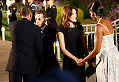 Pittsburgh, PA - September 24, 2009 -- United States President Barack Obama (L) talks with French President Nicolas Sarkozy (2L) while Sarkozy's wife Carla Bruni Sarkozy (2R) talks with U.S. first lady Michelle Obama before the opening dinner for G-20 leaders at the Phipps Conservatory on Thursday, September 24, 2009 in Pittsburgh, Pennsylvania. Heads of state from the world's leading economic powers arrived today for the two-day G-20 summit held at the David L. Lawrence Convention Center aimed at promoting economic growth.  .Credit: Win McNamee / Pool via CNP