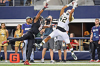Baylor inside receiver Levi Norwood (42) catches a pass while defended by Texas Tech defensive back Austin Stewart (8) during an NCAA Football game, Saturday, November 29, 2014 in Arlington, Tex. Baylor defeated Texas Tech 48-46. (Mo Khursheed/TFV Media via AP Images)