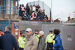 "Portsmouth 1 Southampton 1, 18/12/2012. Fratton Park, Championship. Southampton fans making their way into the away end at Fratton Park stadium through a closed-off street before Portsmouth take on local rivals Southampton in a Championship fixture. Around 3000 away fans were taken directly to the game in a fleet of buses in a police operation known as the ""coach bubble"" to avoid the possibility of disorder between rival fans. The match ended in a one-all draw watched by a near capacity crowd of 19,879. Photo by Colin McPherson."