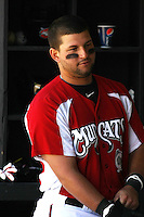 Yonder Alonzo #19 of the Carolina Mudcats in the dugout preparing to bat during a game against the Chattanooga Lookouts on on May 9, 2010 in Zebulon, NC.