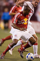 Red Bulls' (2) Marvell Wynne shields the ball from (11) Nate Jaqua of the Fire during the second half. The Red Bulls played the Fire to a 1-1 tie at Giant's Stadium, East Rutherford, NJ, on May 13, 2006.