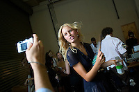 NEW YORK--SEP 9 Supermodel Karolina Kurkova poses for a picture while fanning herself backstage before the Proenza Schouler fashion show at the Milk Gallery during Olympus Fashion Week Spring 2005 in New York City on September 9, 2004. (Photo by Landon Nordeman/Getty Images)