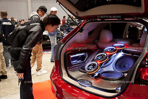 """April 21, 2013, Chiba, Japan - A visitor sees a custom car. The """"New Style Custom Autoshow NEXT 2013"""" for 5th time comes to Makuhari Messe to show luxury custom cars (Lamborghini, Maserati, Cadillac, Honda, Chevrolet, etc) which compete in 16 different """"New Style"""" categories. The exhibition brings beautiful Go-Go dancers who perform on the stage and pose for the cameras of visitors. The car show brings the ultimate of technology in illumination, audio and video system; car accessories, rims and new designs on chassis, everything to custom luxury cars. (Photo by Rodrigo Reyes Marin/AFLO).."""