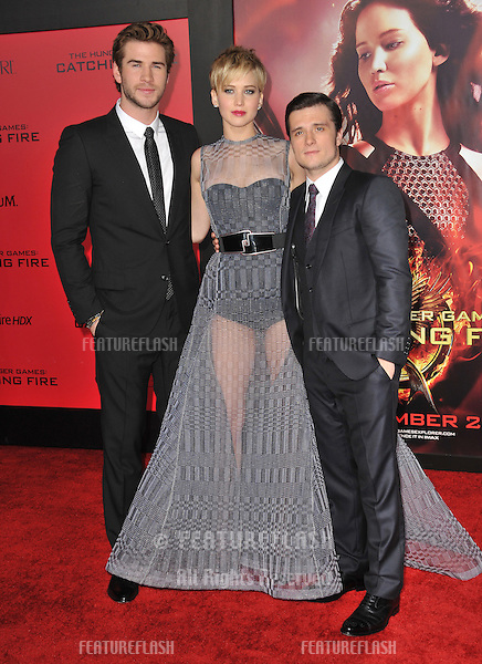 Jennifer Lawrence with Liam Hemsworth (left) &amp; Josh Hutcherson at the US premiere of their movie &quot;The Hunger Games: Catching Fire&quot; at the Nokia Theatre LA Live.<br /> November 18, 2013  Los Angeles, CA<br /> Picture: Paul Smith / Featureflash