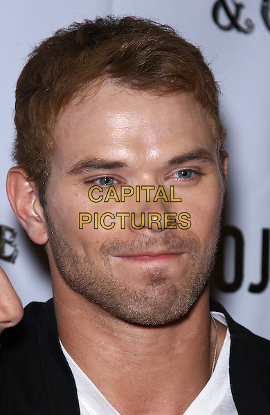 Kellan Lutz.Kellan Lutz celebrates Dylan George and Abbot+Main Spring 2012 collections at Chateau Nightclub inside Paris Las Vegas, Las Vegas, Nevada, USA..August 23rd, 2011.headshot portrait black white stubble facial hair funny.CAP/ADM/MJT.© MJT/AdMedia/Capital Pictures.