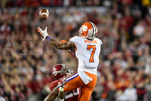 09.01.2017. Tampa, Florida, USA.  Clemson University wide receiver Mike Williams (7) makes a crucial catch for a first down whiled defended by University of Alabama defensive back Anthony Averett (28) during second half of the CFP National Championship game between the Alabama Crimson Tide and the Clemson Tigers on January 09, 2017, at Raymond James Stadium in Tampa, FL. Clemson defeated Alabama 35-31to win the National Championship.