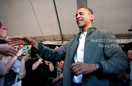 United States President Barack Obama (R) greets patrons as he visits a bar in celebration of St. Patrick's day at the Dubliner Restaurant and Pub on March 17, 2012 in Washington, DC. Next week, Obama and Vice President Biden will meet the Irish Prime Minister Enda Kenny and attend a St. Patrick's Day lunch at the Capitol..Credit: Joshua Roberts / Pool via CNP