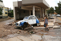 Pictured: A car is deserted on a road covered by debris in the Mandra area, in the outskirts of Athens, Greece. Wednesday 27 June 2018<br /> Re: Flashflooding has been caused by storm Nefeli in parts of Greece.