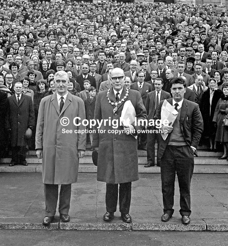 Some of the estimated 25,000 who took part in the University for Derry Campaign Motorcade from Londonderry pose on the steps of Parliament Buildings, Stormont, Belfast, on 18 February 1965. The campaign was lead by (from left) Eddie McAteer, Nationalist MP for Foyle, Albert Anderson, Mayor of Derry, and John Hume, campaign organiser. This last ditch effort to secure the new university for Derry failed as on March 4 1965 the Stormont Parliament voted in favour of the Lockwood Report's choice, Coleraine. 196502180001<br />