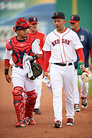 Salem Red Sox catcher Isaias Lucena (left) and starting pitcher Bryan Mata (right) walk to the dugout before a game before a game against the Lynchburg Hillcats on May 10, 2018 at Haley Toyota Field in Salem, Virginia.  Lynchburg defeated Salem 11-5.  (Mike Janes/Four Seam Images)