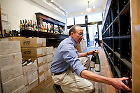 Co-owner David Lillie selects bottles from the shelves at Chambers Street Wines in New York, NY, USA, 22 May 2009. The store specializes in naturally made wines from artisanal small producers and has received a Slow Food NYC Snail of Approval.