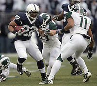 State College, PA - 11/27/2010:  RB Evan Royster (22) carries ball while attempting to avoid Michigan State defenders Eric Gordon (43) and Marcus Hyde (11).  Royster carried the ball 14 times for 85 yards and one touchdown.  Penn State lost to Michigan State by a score of 28-22 on Senior Day at Beaver Stadium...Photo:  Joe Rokita / JoeRokita.com..Photo ©2010 Joe Rokita Photography