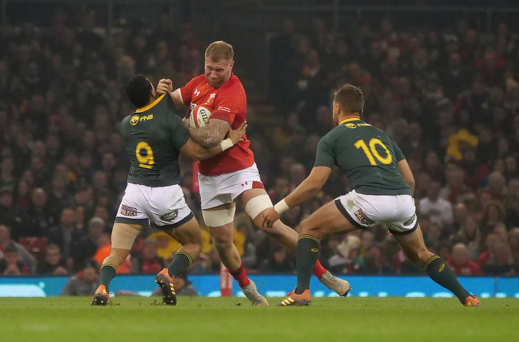 Wales' Ross Moriarity palms off South Africa's Embrose Papier<br /> <br /> Photographer Ian Cook/CameraSport<br /> <br /> Under Armour Series Autumn Internationals - Wales v South Africa - Saturday 24th November 2018 - Principality Stadium - Cardiff<br /> <br /> World Copyright © 2018 CameraSport. All rights reserved. 43 Linden Ave. Countesthorpe. Leicester. England. LE8 5PG - Tel: +44 (0) 116 277 4147 - admin@camerasport.com - www.camerasport.com
