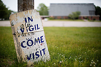 "A sign outside reads ""In vigil / come visit"" at St. Frances Xavier Cabrini Church in Scituate, Mass., on Sun., May 29, 2016. Members of the congregation have been holding a vigil for more than 11 years after the Archdiocese of Boston ordered the parish closed in 2004. For 4234 days, at least one member of Friends of St. Frances X. Cabrini has been at the church at all times, preventing the closure of the church. May 29, 2016, was the last service held at the church after members finally agreed to leave the building after the US Supreme Court decided not to hear their appeal to earlier an Massachusetts court ruling stating that they must leave. The last service was called a ""transitional mass"" and was the first sanctioned mass performed at the church since the vigil began."