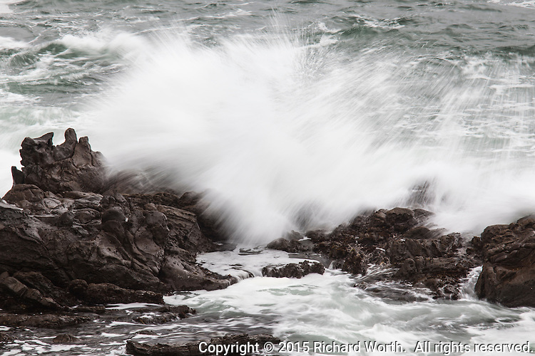 Waves crashing onto the rocks at Bean Hollow State Beach, softened and blurred with camera technique.