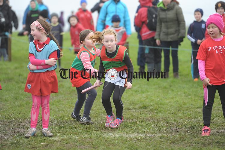 KIB's Aoife Ferguson hands the baton over to Sophie Sexton at the Clare Cross Country Junior and Juvenile Relay championships in Clonlohan, Newmarket on Fergus. Photograph by John Kelly.