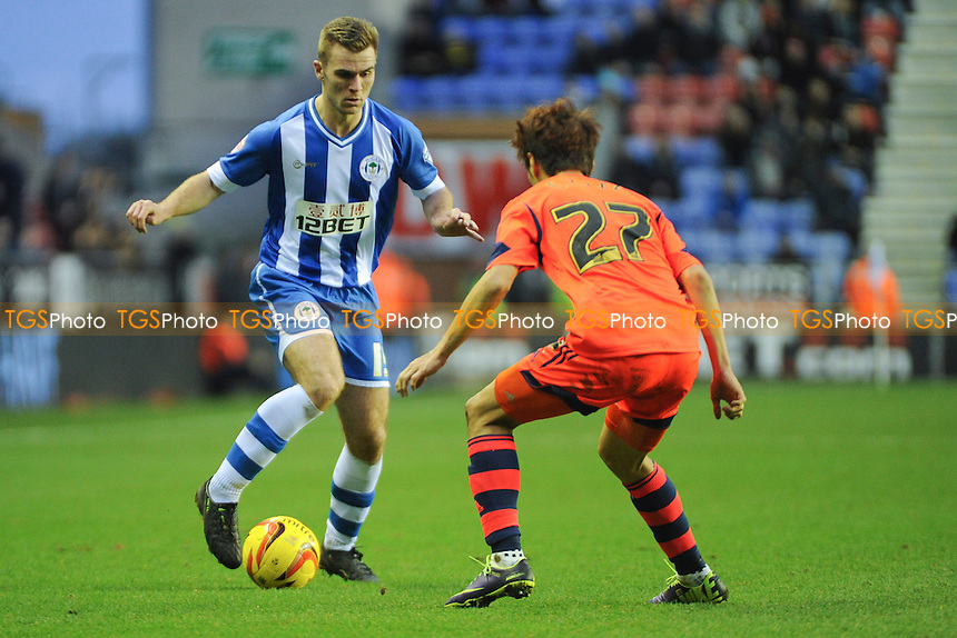 Callum McManaman of Wigan Athletic controls the ball in front of Lee Chung-Yong of Bolton Wanderers - Wigan Athletic vs Bolton Wanderers - Sky Bet Champiosnhip Football at the DW Stadium, Wigan - 15/12/13 - MANDATORY CREDIT: Greig Bertram/TGSPHOTO - Self billing applies where appropriate - 0845 094 6026 - contact@tgsphoto.co.uk - NO UNPAID USE