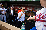 UNITED STATES - JUNE 11: President Barack Obama shakes hands with Rep. Linda Sanchez, D-Calif., as other players in the Democrats' dugout look on during the 54th Annual Roll Call Congressional Baseball Game at Nationals Park in Washington on Thursday, June 11, 2015. The Democrats beat the Republicans 5-2. (Photo By Bill Clark/CQ Roll Call)