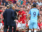 Josep Guardiola manager of Manchester City pats Wayne Rooney of Manchester United after withholding the ball during the Premier League match at Old Trafford Stadium, Manchester. Picture date: September 10th, 2016. Pic Simon Bellis/Sportimage