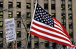 War protests at the Federal Building in downtown Seattle people holding American Flag and signs  protesting the US involvement in Persian Gulf January 15 deadline 1991 Seattle Washington State USA