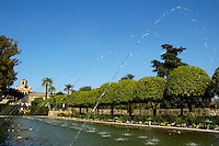 Water fountains spraying in the gardens at the Alcazar de los Reyes Cristianos, a medieval palace in Cordoba, Andalusia, Spain.