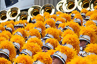 Members of the West Virginia University Mountaineer Marching Band pose for a group photograph after performing in the Macy's Thanksgiving Day Parade in New York on Thursday, November 24, 2016. (© Richard B. Levine)