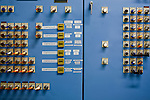 Detail of a control panel in the mechanical room controlling the freezer at the National Ice Core Laboratory...National Ice Core Laboratory, Lakewood, Colo.  Photographs from inside the laboratory and its storage space.  Ice core samples are drilled and transported from ice sheets in Greenland and Anarctica and transportd to the Ice Core Lab for processing and distribution to laboratories that have received grants from the National Science Foundation.  Because the cores trap greenhouse gas and ash samples, climate scientists can extract data about the Earth's climate from upwards of 400,000 years ago.  Samples are packed in silver tubes, placed in insulated boxes, and shipped from the ice caps in refrigerated cargo containers; the storage space is kept at -36 degrees Farenheit.