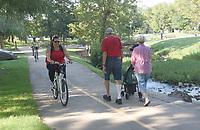 NWA Democrat-Gazette/FLIP PUTTHOFF <br /> The 40-mile Razorback Greenway is popular for biking, walking and running.