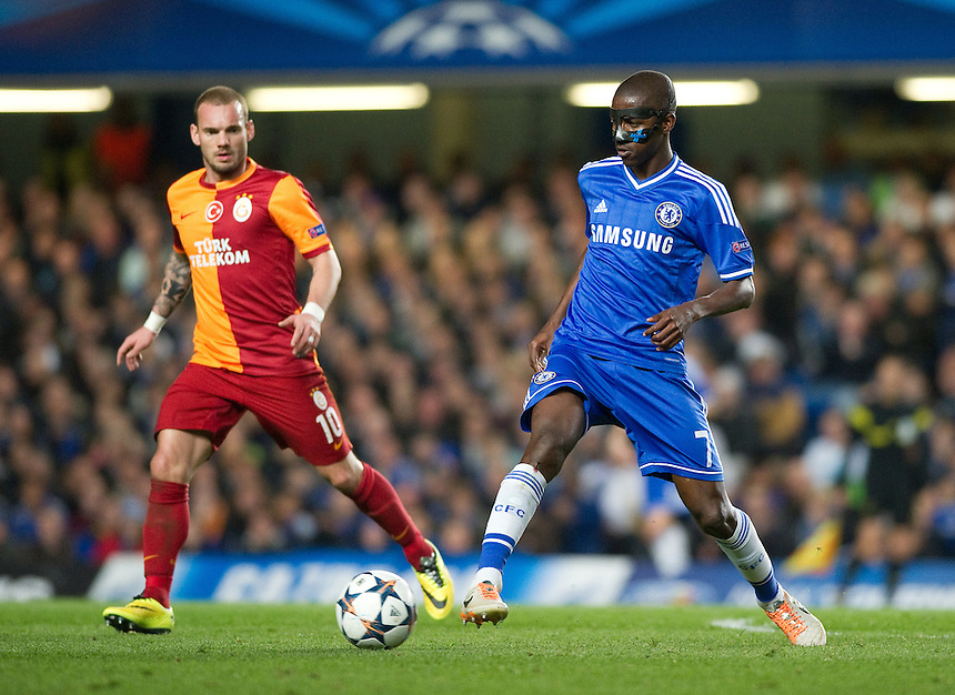 Chelsea's Ramires holds off the challenge from Galatasaray's Wesley Sneijder<br /> <br /> Photo by Ashley Western/CameraSport<br /> <br /> Football - UEFA Champions League First Knockout Round 2nd Leg - Chelsea v Galatasaray - Tuesday 18th March 2014 - Stamford Bridge - London<br />  <br /> &copy; CameraSport - 43 Linden Ave. Countesthorpe. Leicester. England. LE8 5PG - Tel: +44 (0) 116 277 4147 - admin@camerasport.com - www.camerasport.com