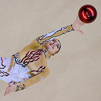 Anna Gurbanova (AZE) performs with the ball during the final of the 2nd Garantiqa Rythmic Gymnastics World Cup held in Debrecen, Hungary. Sunday, 07. March 2010. ATTILA VOLGYI