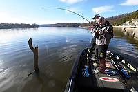 NWA Democrat-Gazette/FLIP PUTTHOFF<br />Tiffany Usrey of Springdale catches a crappie near Horseshoe Bend park on Nov. 24 2017 while she and her husband, Payton (left) fish at Beaver Lake. The couple cast jigs around submerged timber and docks to catch several crappie.