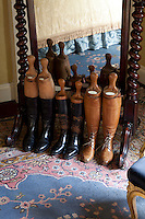 A row of antique leather boots in the King's Room