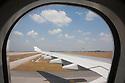 A wing viewed from an airplane window at Kuala Lumpur International Airport. Kuala Lumpur, Malaysia