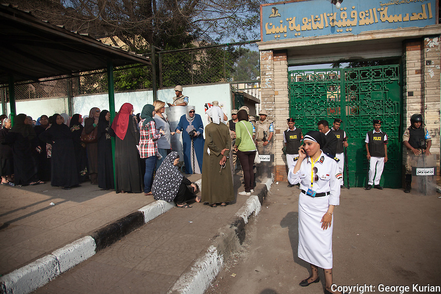 Polling station in Shubra, Cairo.<br /> <br /> Women wait in line outside the heavily guarded polling station.
