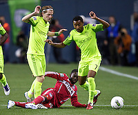 Chicago Fire forward Patrick Nyarko, center slides between Seattle Sounders FC defender James Riley, right, and midfielder Erik Friberg during play between the Seattle Sounders FC and the Chicago Fire in the U.S. Open Cup Final at CenturyLink Field in Seattle Tuesday October 4, 2011. Seattle won the game 2-0 to win its third U.S. Open Cup.