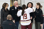 Patricia Doherty, Thomas Doherty, Danielle Doherty (BC - 19), Courtney Kennedy (BC - Associate Head Coach), Katie King Crowley (BC - Head Coach) -  The Boston College Eagles defeated the visiting Boston University Terriers 5-0 on BC's senior night on Thursday, February 19, 2015, at Kelley Rink in Conte Forum in Chestnut Hill, Massachusetts.