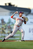 Auburn Doubledays second baseman Bryan Mejia (1) attempts to turn a double play during a game against the Batavia Muckdogs on August 27, 2014 at Dwyer Stadium in Batavia, New York.  Auburn defeated Batavia 6-4.  (Mike Janes/Four Seam Images)