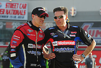 Mar. 30, 2012; Las Vegas, NV, USA: NHRA funny car driver Bob Tasca III (left) with father Bob Tasca II during qualifying for the Summitracing.com Nationals at The Strip in Las Vegas. Mandatory Credit: Mark J. Rebilas-US PRESSWIRE