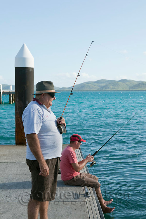 FIshing off the jetty at Engineers Wharf.  Thursday Island, Torres Strait Islands, Queensland, Australia