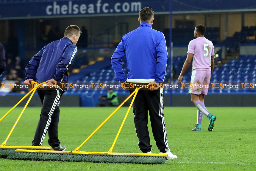Chelsea ground staff patiently wait for the Reading players to leave the field before starting work on the pitch during Chelsea Youth vs Reading Youth, FA Youth Cup Football at Stamford Bridge