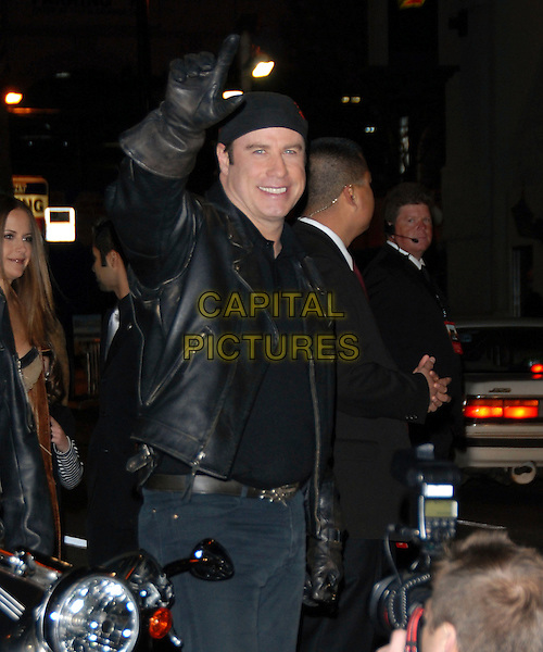 "JOHN TRAVOLTA.attends The Touchstone Pictures' World Premiere of ""Wild Hogs"" held at The El Capitan Theatre in Hollywood, California, USA, February 27 2007. .half length black leathers hat  biker glove hand finger.CAP/DVS.©Debbie VanStory/Capital Pictures"