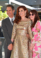 Eric McCormack, Debra Messing, Megan Mullally at the Hollywood Walk of Fame Star Ceremony honoring actress Debra Messing on Hollywood Boulevard, Los Angeles, USA 06 Oct. 2017<br /> Picture: Paul Smith/Featureflash/SilverHub 0208 004 5359 sales@silverhubmedia.com